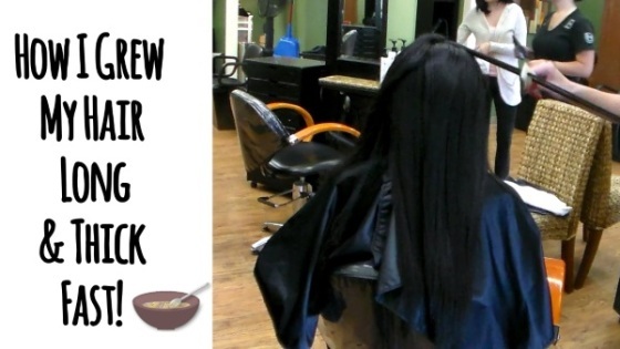 black girl with waist length hair at salon getting a press